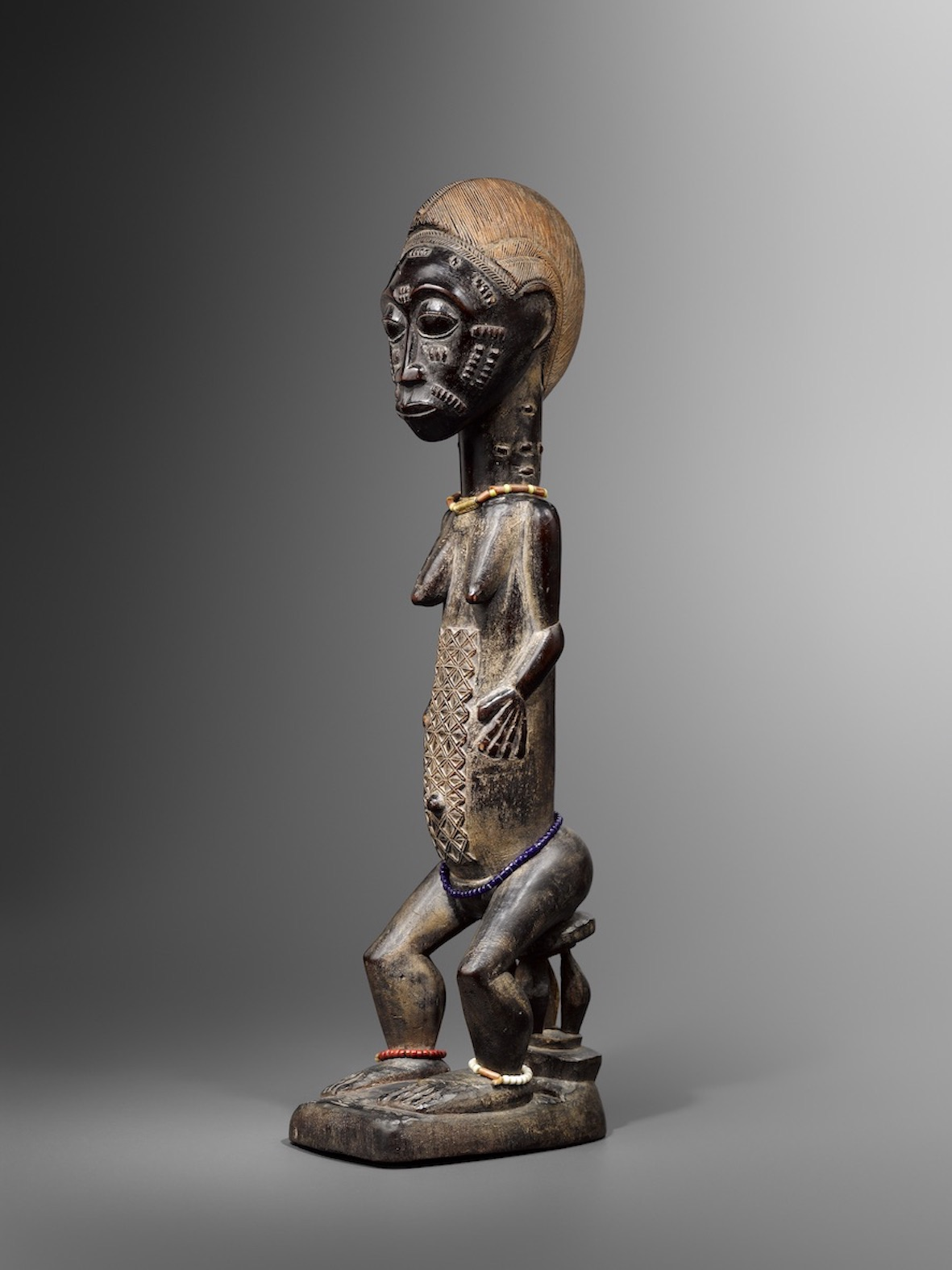 A seated Baoule Figure